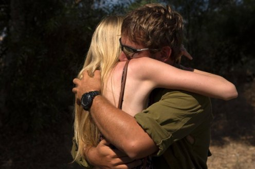 An Israeli soldier reunites with his girlfriend during a 12-hour ceasefire, near Sderot